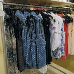 In the tops section: basic and graphic tees and tanks from $4.99 to $9.99, plus collared blouses and vests from $19.99 to $29.99.