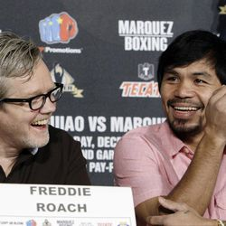 Manny Pacquiao, of the Philippines, right, and his trainer Freddie Roach laugh at a news conference to promote his upcoming boxing match against Juan Manuel Marquez in Beverly Hills, Calif., Monday, Sept. 17, 2012. The two will fight for the fourth time on Dec. 8 in Las Vegas.