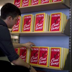 """An employee adjusts copies of  """"The Casual Vacancy"""" by author J.K. Rowling at a book store in London, Thursday, Sept. 27, 2012.  British bookshops are opening their doors early as Harry Potter author J.K. Rowling launches her long anticipated first book for adults.  Publishers have tried to keep details of the book under wraps ahead of its launch Thursday, but """"The Casual Vacancy"""" has gotten early buzz about references to sex and drugs that might be a tad mature for the youngest """"Potter"""" fans."""