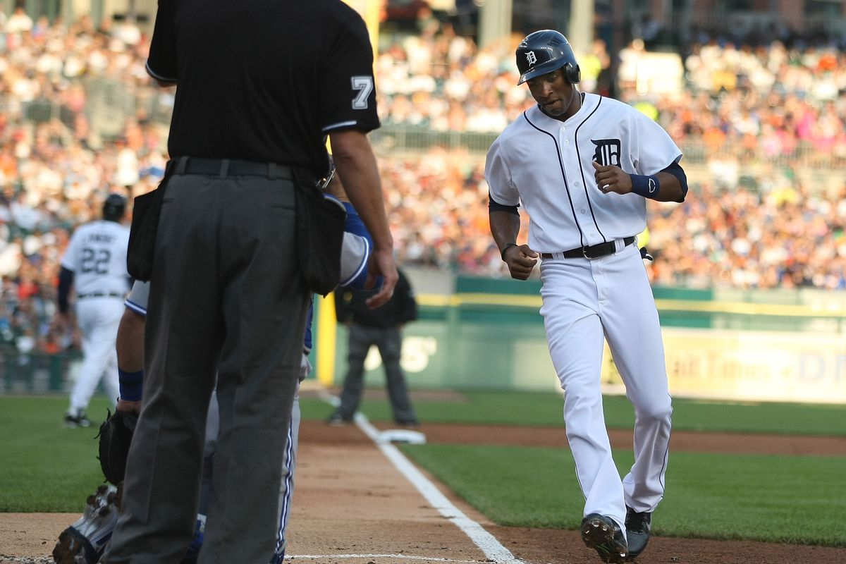 Austin Jackson #14 of the Detroit Tigers scores a run after a walk in the first inning during a MLB game against the Toronto Blue Jays  at Comerica Park on August 21, 2012 in Detroit, Michigan.  (Photo by Dave Reginek/Getty Images)