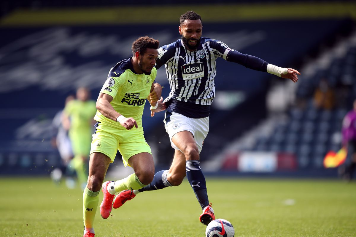 Newcastle United's Joelinton and West Bromwich Albion's Kyle Bartley battle for the ball during the Premier League match at The Hawthorns, West Bromwich.