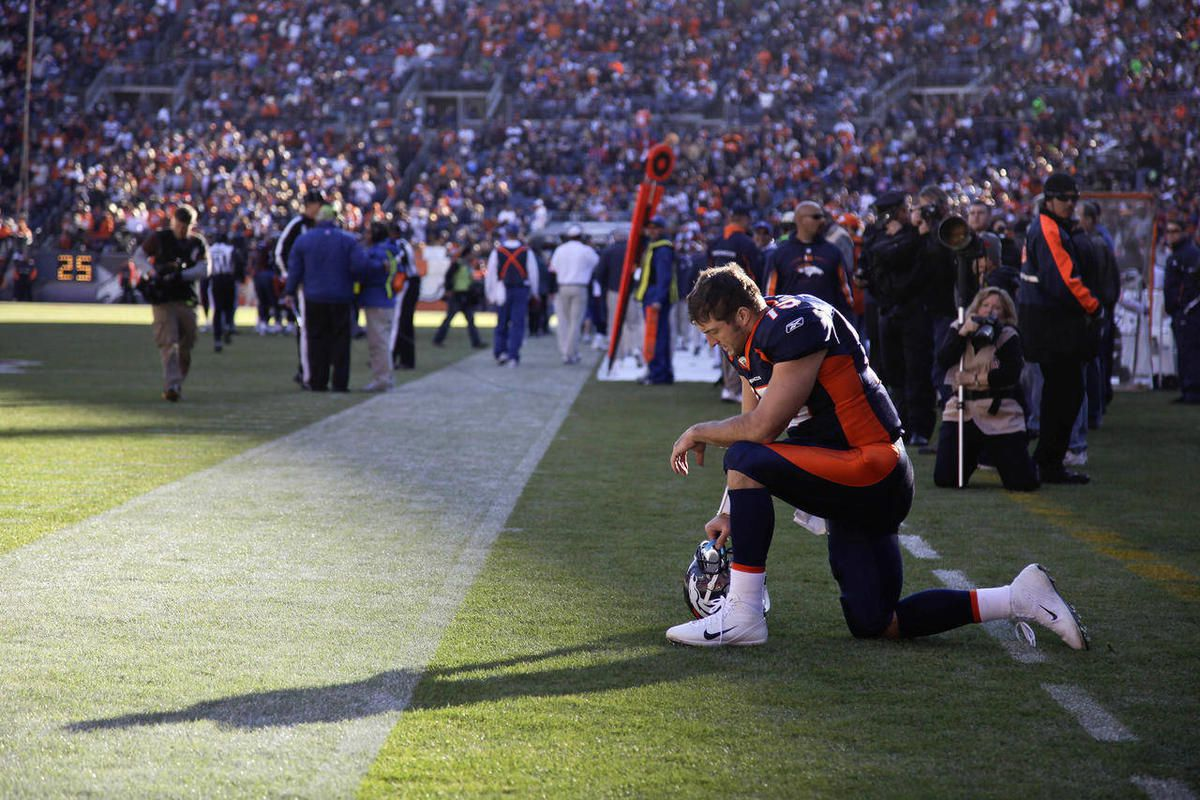 In this Dec. 11, 2011 file photo, Denver Broncos quarterback Tim Tebow prays in the end zone before the start of an NFL football game against the Chicago Bears,  in Denver. Tebow recently trademarked the prayerful pose.