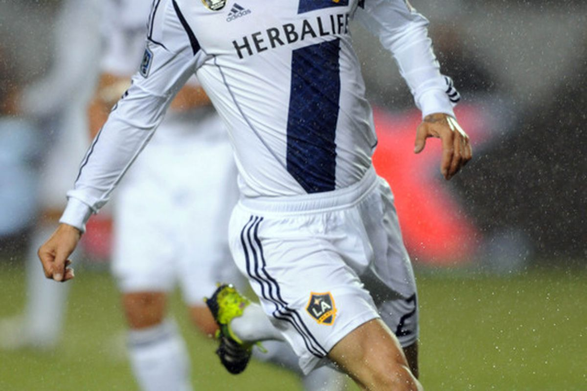Mar 31, 2012; Carson, CA, USA; Los Angeles Galaxy midfielder David Beckham (23) handles the ball in the rain against the New England Revolution during the first half at the Home Depot Center. Mandatory Credit: Kelvin Kuo-US PRESSWIRE