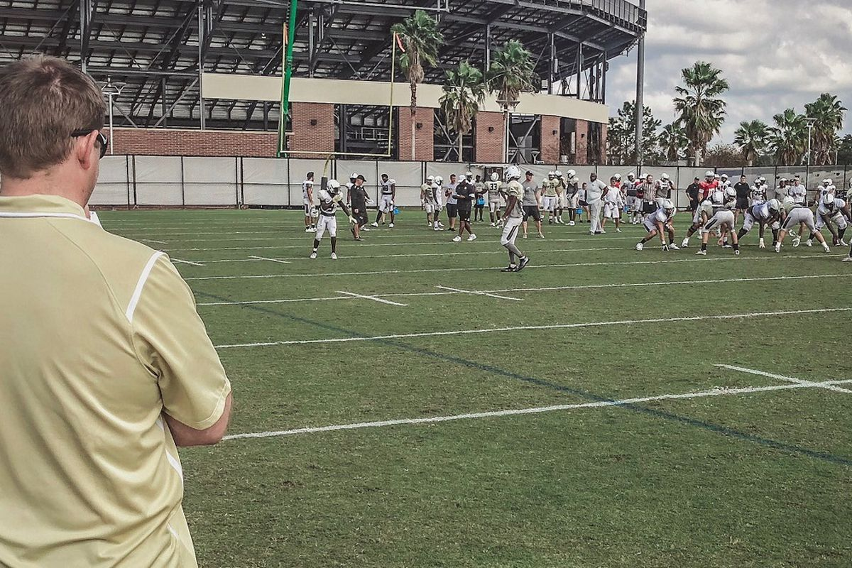 New UCF head coach Josh Heupel took time out from confirming recruits Wednesday to watch the current Knights practice for the upcoming Peach Bowl. (Photo: UCF Football's Twitter feed)