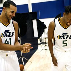 Utah Jazz guard Rodney Hood, right, laughs at forward Trey Lyles after Lyles wanted a rematch in Rock-Paper-Scissors during Media Day at Zions Bank Basketball Center in Salt Lake City on Monday, Sept. 26, 2016.
