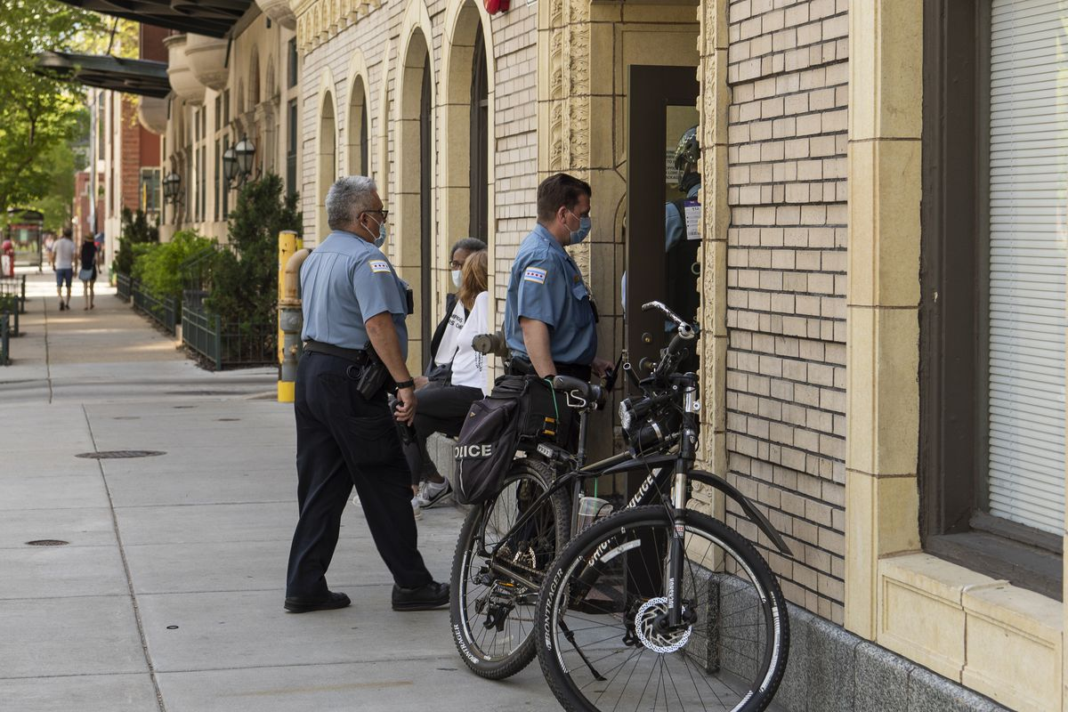 Chicago police conduct a death investigation at an apartment building in the 1500 block of North LaSalle Dr., Monday, May 25, 2020.