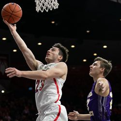 Arizona's Alex Barcello (23) lays in the ball during the Arizona-Western New Mexico University game in McKale Center on October 30 2018 in Tucson, Ariz.