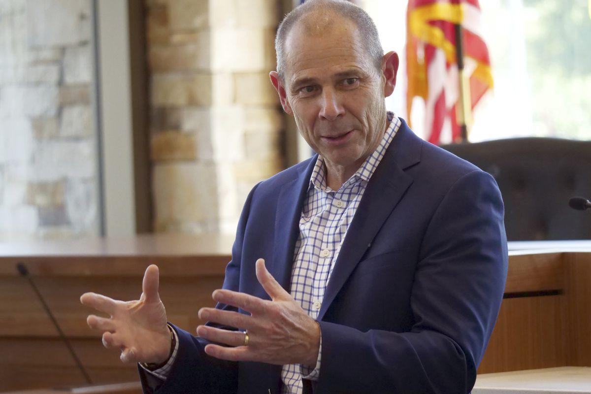 In this Saturday, June 23, 2018, photo, U.S. Rep. John Curtis speaks during a town hall meeting, in Cottonwood Heights, Utah.