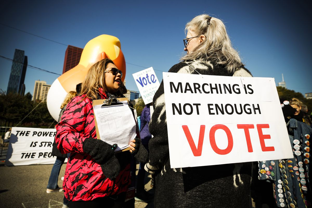 Women gather for a rally at Grant Park to inspire voter turnout ahead of the midterms in Chicago, Illinois, on October 13, 2018.