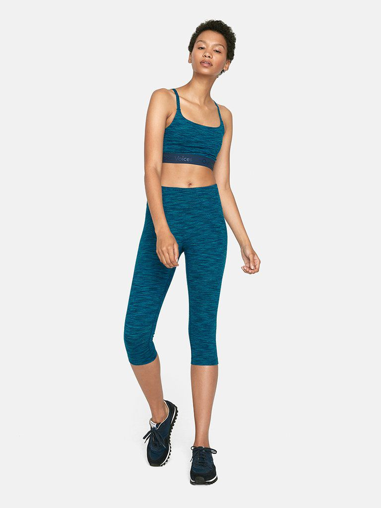 A model in blue workout clothes