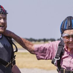 """Jason Ashcroft, left, stands with his grandfather, Wendell Ashcroft, after they successfully skydived for the first time at Skydive Ogden in Ogden on Saturday, Aug.5, 2017. """"I'm about 20 years too late,"""" says Wendell. """"My hearing and sight are going."""""""