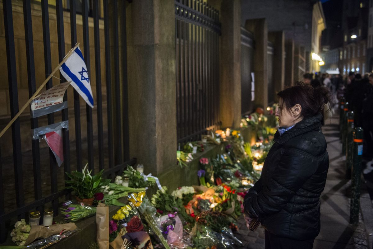 Well wishers bring flowers and light candles to honor the shooting victims outside the main synagogue in Copenhagen, Denmark on February 15, 2015.