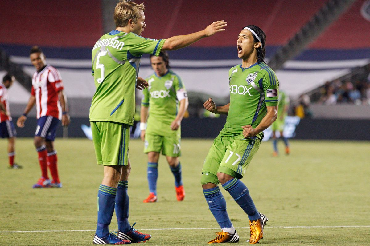 Adam Johansson (Thor) tells Fredy Montero that he was called up to the Swedish National Team.(Photo by Ric Tapia/Getty Images)
