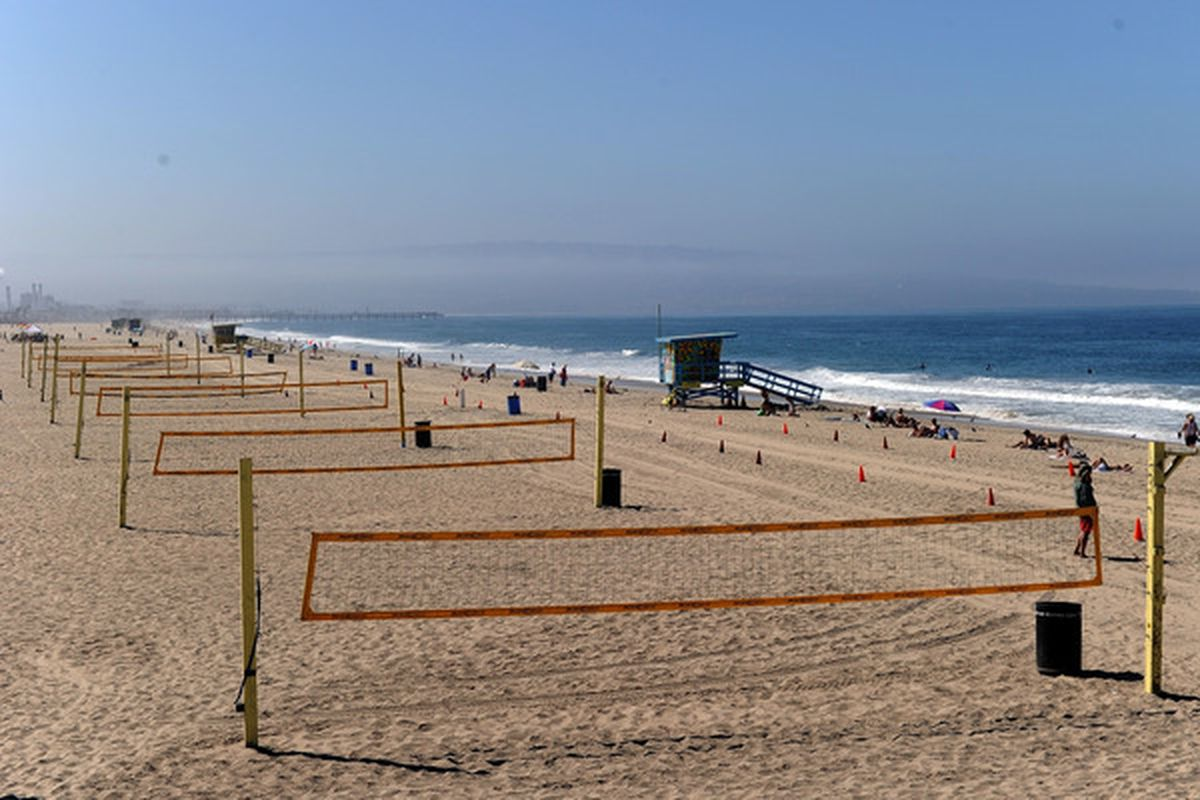 MANHATTAN BEACH CA - AUGUST 20:  Beach volleyball courts sit empty after qualification for the Manhattan Beach Open was cancelled at Manhattan Beach on August 20 2010 in Manhattan Beach California.  (Photo by Harry How/Getty Images)