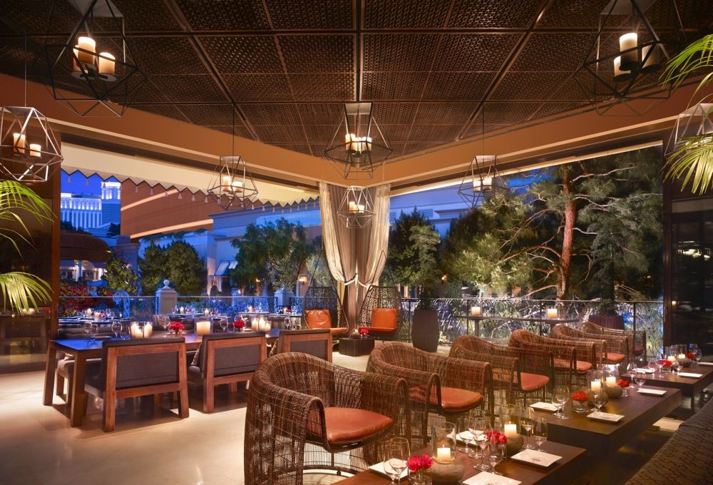Covered restaurant patio surrounded by trees