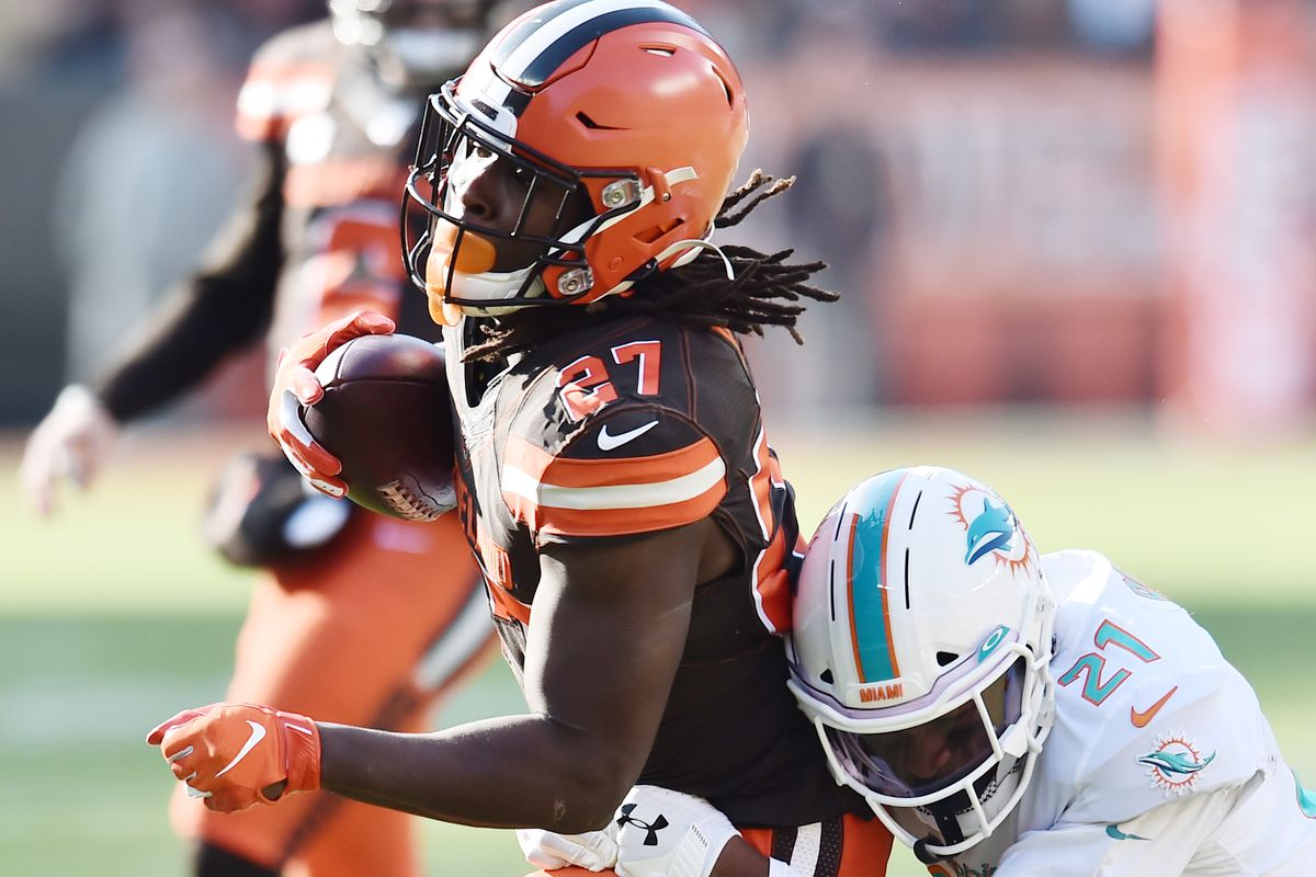 Miami Dolphins cornerback Eric Rowe tackles Cleveland Browns running back Kareem Hunt during the first half at FirstEnergy Stadium.