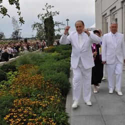 LDS Church President Thomas S. Monson gestures to onlookers as he walks to dedication services in the temple after the cornerstone ceremony. He is joined by President Dieter F. Uchtdorf, second counselor in the First Presidency, after the cornerstone ceremony at the Kyiv Ukraine Temple dedication services, Sunday, Aug. 28, 2010, in Kiev, Ukraine.