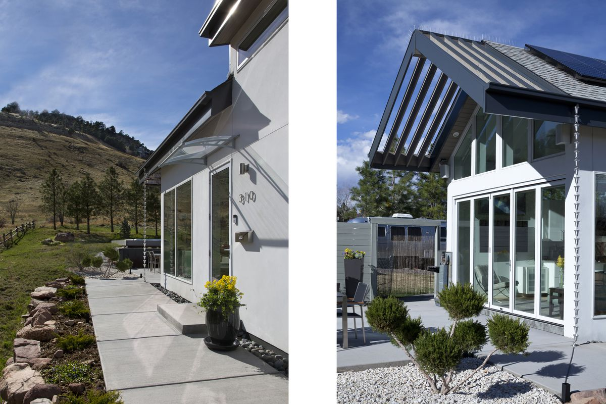 The house sits in the middle of scenic mountains and fields. Large glass windows and doors make the indoor-outdoor connection strong and immediate.