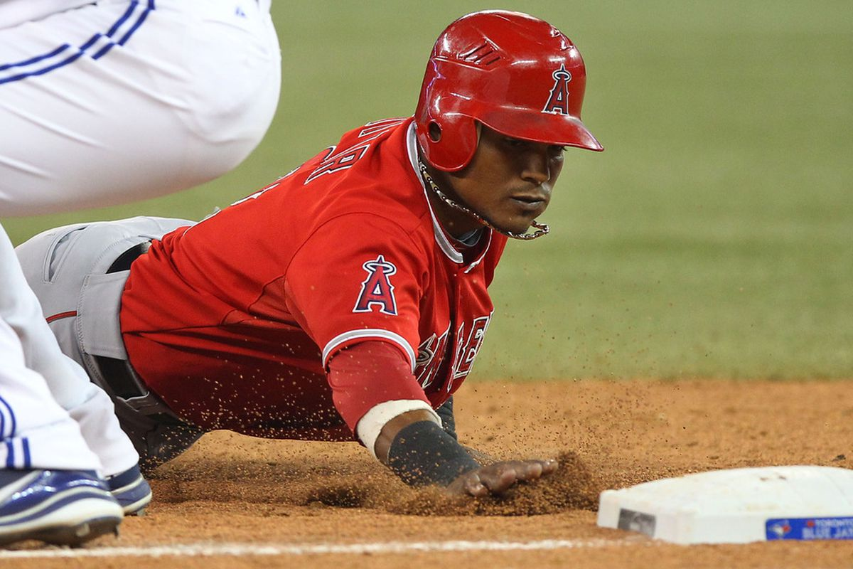 Jun 29, 2012; Toronto, ON, Canada; Los Angeles Angels shortstop Erick Aybar (2) dives back to first base against the Toronto Blue Jays at the Rogers Centre. The Blue Jays beat the Angels 7-5. Mandatory Credit: Tom Szczerbowski-US PRESSWIRE