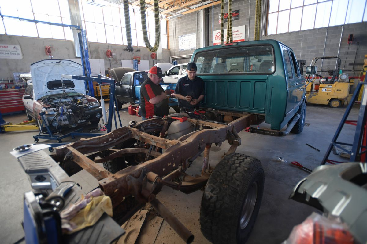 Colorado Northwestern Community College Automotive Technology Lead Instructor Dale Updike works with student Ryan Trussell.