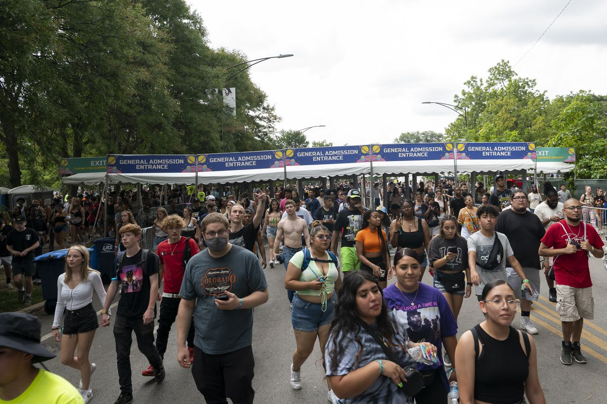 Summer Smash Festival attendees begin to evacuate Douglass Park as sever weather moves in.