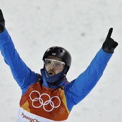 Jonathon Lillis, of the United States, celebrates after his run during the men's aerial final at Phoenix Snow Park at the 2018 Winter Olympics in Pyeongchang, South Korea, Sunday, Feb. 18, 2018. (AP Photo/Lee Jin-man)