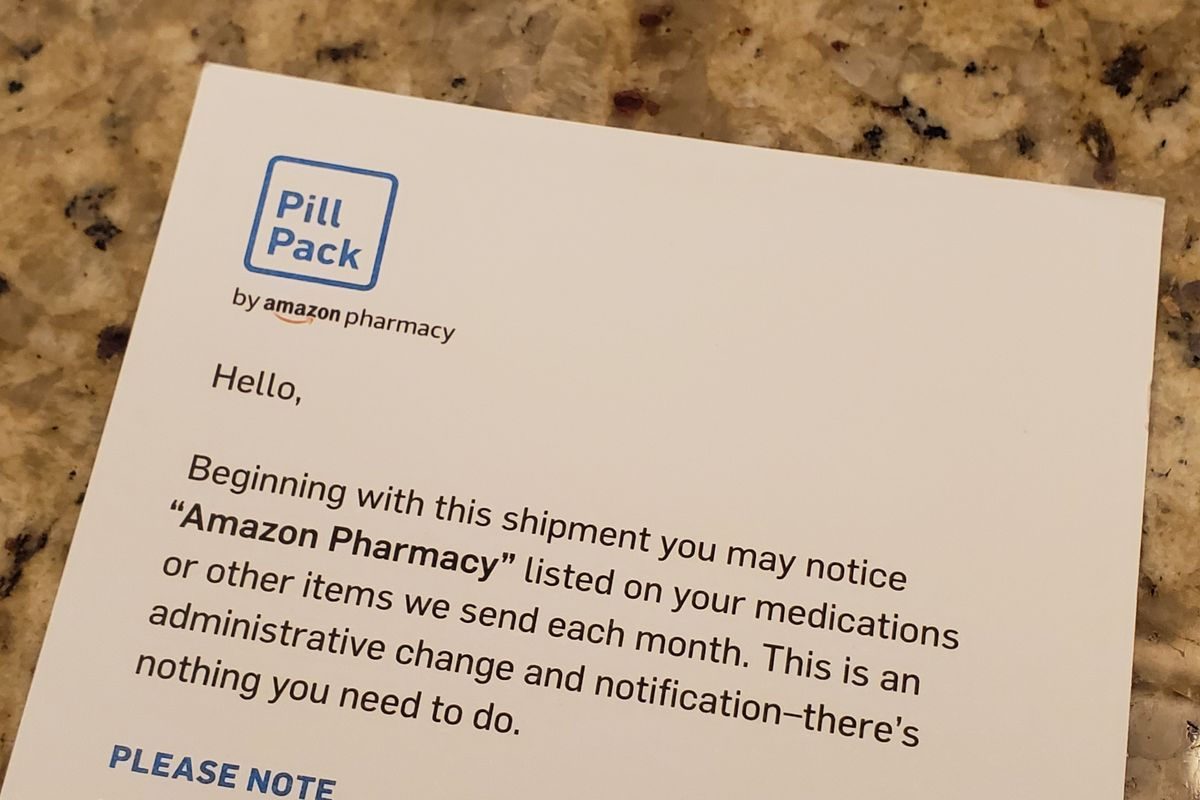 """A printed insert from PillPack announcing that """"Amazon Pharmacy"""" will now be listed on medications."""