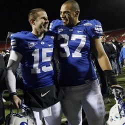 BYU's #15 Max Hall is hugged by teammate #37 Vic So'oto after BYU defeated Oregon State in the Maaco Bowl in Las Vegas 44-20.  Tuesday, Dec. 22, 2009. Photo by Scott G Winterton Deseret News.