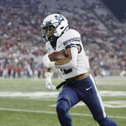 Utah State wide receiver Deven Thompkins carries the ball during the second half of an NCAA college football game against Washington State, Saturday, Sept. 4, 2021, in Pullman, Wash. Utah State won 26-23.