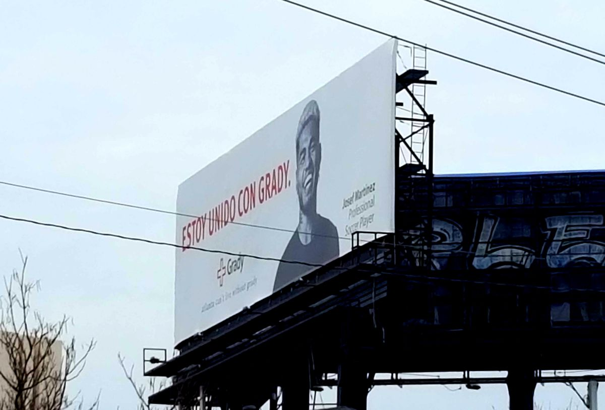 A billboard for Grady Memorial Hospital with Josef Martinez's face.