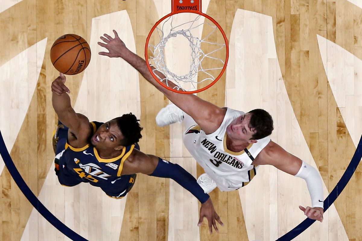 Utah Jazz guard Donovan Mitchell (45) goes to the basket against New Orleans Pelicans forward Nikola Mirotic (3) in the first half of an NBA basketball game in New Orleans, Saturday, Oct. 27, 2018.