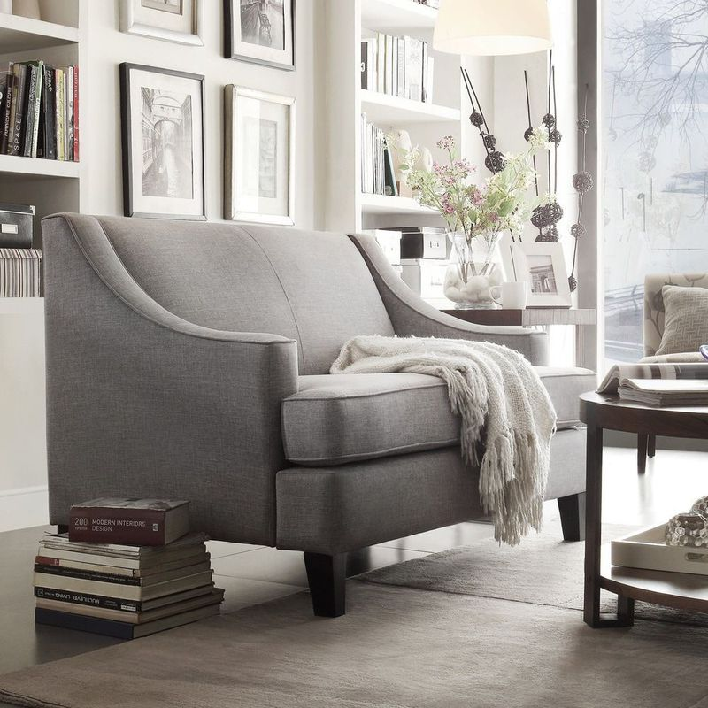 Gray loveseat with sloped arms.