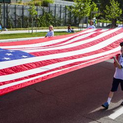 The Lake Ridge School Honor Guard carries the flag during the Days of '47 Union Pacific Railroad Youth Parade held Saturday, July 18, 2015, in Salt Lake City.