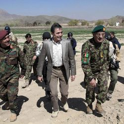 NATO Secretary-General Anders Fogh Rasmussen, center, arrives at the Afghan commando training center in Kabul, Afghanistan, Thursday, April 12, 2012. Rasmussen, said Afghan troops would be ready to take the lead role around the country by mid-2013, allowing international combat forces to move into a support and training role.