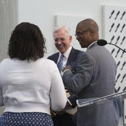 Elder D. Todd Christofferson, a member of the LDS Church's Quorum of the Twelve Apostles, talks with Jermaine Sullivan and another participant after a news conference at the California African American Museum in Los Angeles on Friday, June 19, 2015.