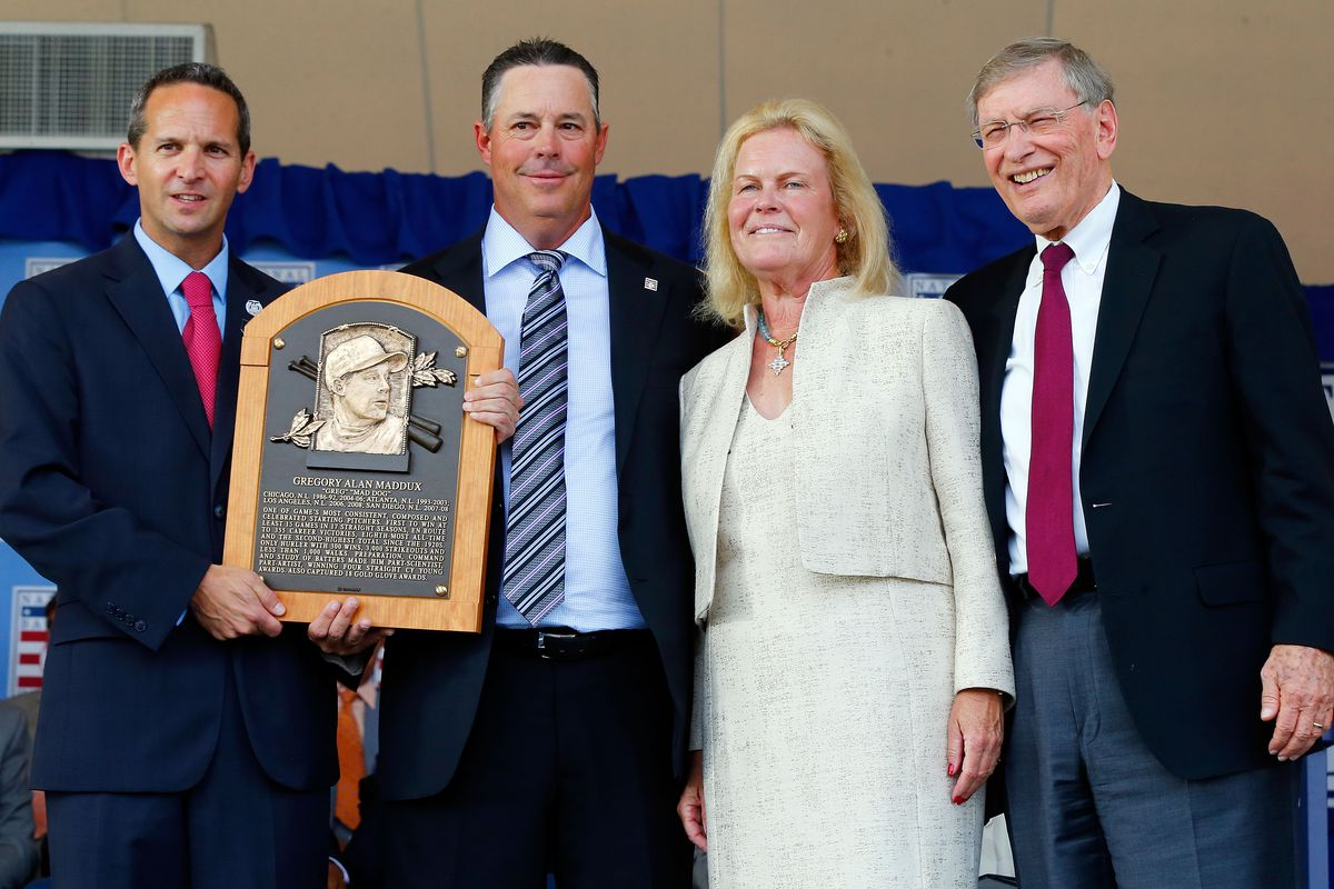 Greg Maddux gets his Hall of Fame plaque. Left: Hall of Fame president Jeff Idelson. Right: Hall of Fame Chairperson Jane Forbes Clark and MLB Commissioner Bud Selig