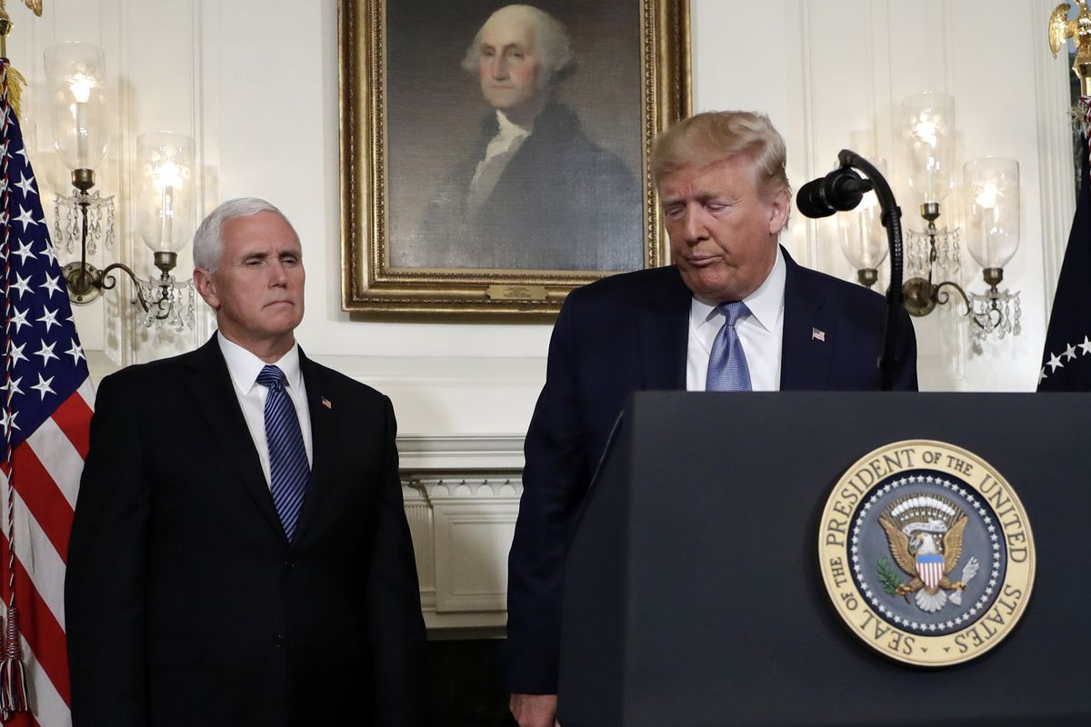 President Donald Trump walks away after speaking about the mass shootings in El Paso, Texas and Dayton, Ohio, in the Diplomatic Reception Room of the White House, Monday, Aug. 5, 2019, in Washington. Vice President Mike Pence is left. (AP Photo/Evan Vucci