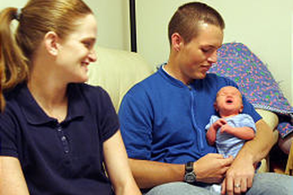 Helen and James Crowther of Provo admire Canyon, who was born Saturday while the couple was in Hobble Creek Canyon.