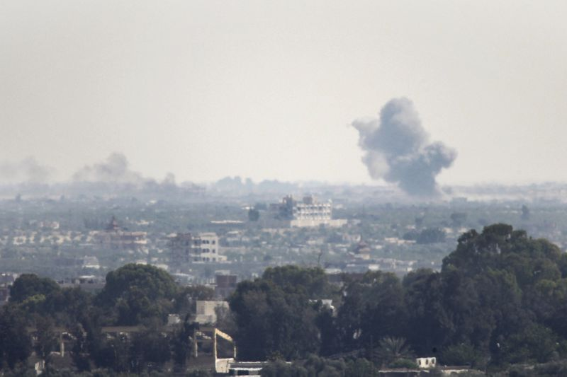 A picture taken from the Rafah border of the southern Gaza Strip with Egypt, shows smoke billowing in Egypt's North Sinai on July 2, 2015. At least 70 people, mostly Egyptian soldiers but also civilians, were killed in attacks and ongoing clashes with Isl