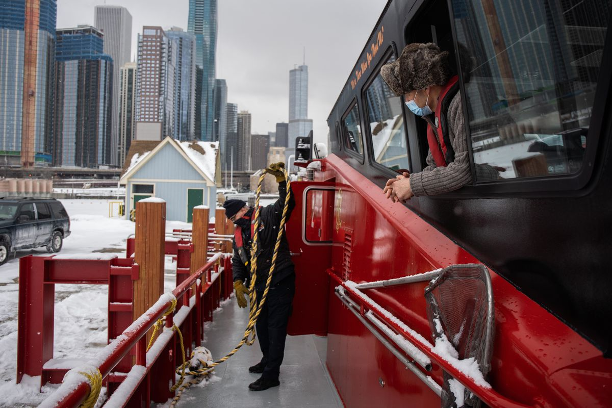 """Pilot Gordon Steiner, right, peers out the window as Chicago Fire Department Firefighter/EMT Richard Musil prepares to undock the """"Christopher Wheatley,"""" Thursday afternoon."""
