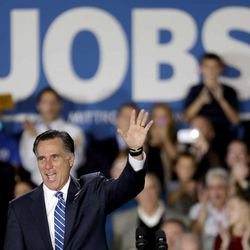 Republican presidential candidate, former Massachusetts Gov. Mitt Romney waves to supporters before speaking at a campaign event at Wisconsin Products Pavilion at State Fair Park, Friday, Nov. 2, 2012, in West Allis, Wic.