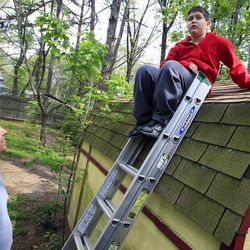 Stuart Chaifetz looks at his son Akian Chaifetz, 10, as he sits on top of a ladder at their home in Cherry Hill, N.J., Wednesday, April 25, 2012. Chaifetz was told that his son Akian was acting violently at his New Jersey school  so he decided to investigate. Akian has autism, as do the rest of the students in the class. This prevented him from being able to explain to his father if anything had been happening to him at school. Chaifetz decided the only way to find out what was behind the outbursts was to send his boy to school wearing a hidden audio recorder.