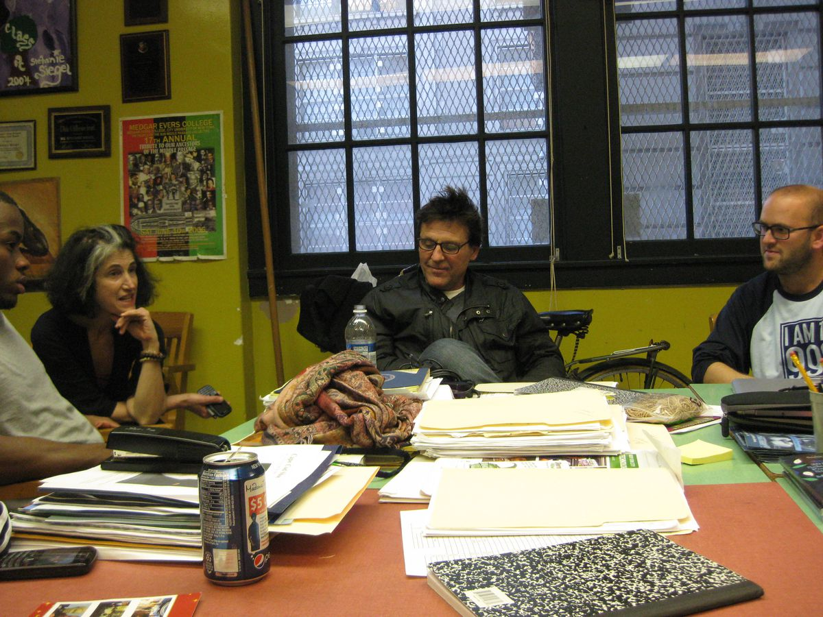 Occupy Wall Street activists Justin Wedes (right), and filmmaker Kevin Breslin (center) speak to a small group of students and staff at Paul Robeson High School, including English teacher Stefanie Siegel (left).