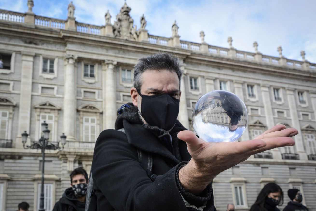 A protester holding a crystal ball during the demonstration...