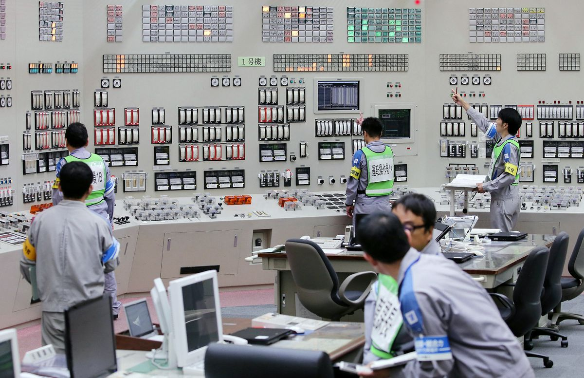 Operators restart the nuclear reactor at the central control room of the Kyushu Electric Power Sendai nuclear power plant