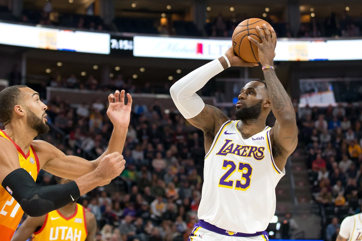 Los Angeles Lakers forward LeBron James shoots the ball against Utah Jazz center Rudy Gobert during the first quarter at Vivint Smart Home Arena.