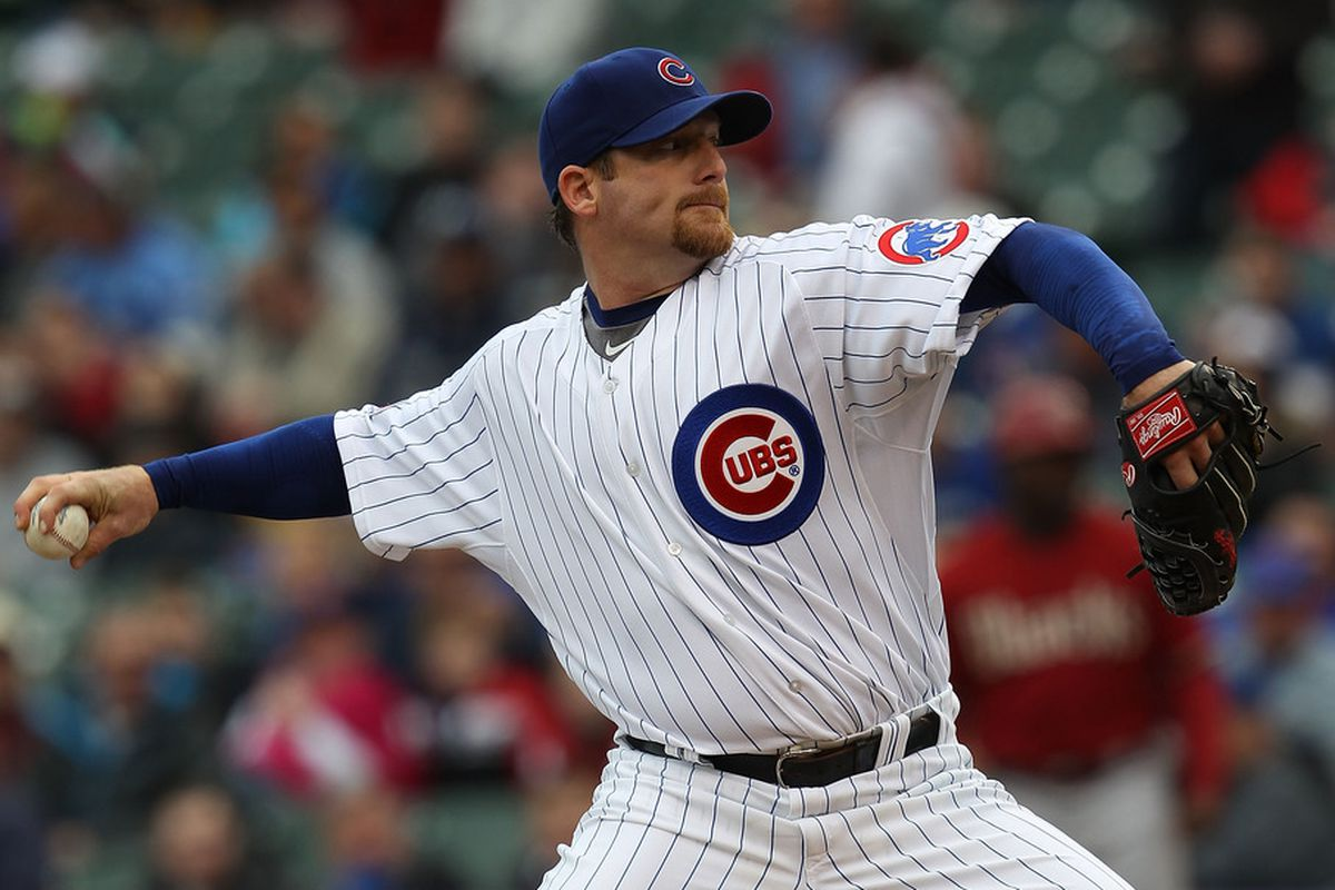 Starting pitcher Ryan Dempster of the Chicago Cubs delivers the ball against the Arizona Diamondbacks at Wrigley Field in Chicago, Illinois. (Photo by Jonathan Daniel/Getty Images)