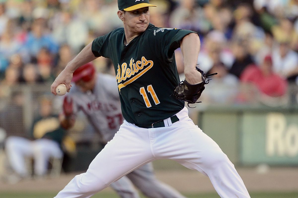 OAKLAND, CA - AUGUST 06:  Jarrod Parker #11 of the Oakland Athletics pitches against the Los Angeles Angels of Anaheim at O.co Coliseum on August 6, 2012 in Oakland, California.  (Photo by Thearon W. Henderson/Getty Images)