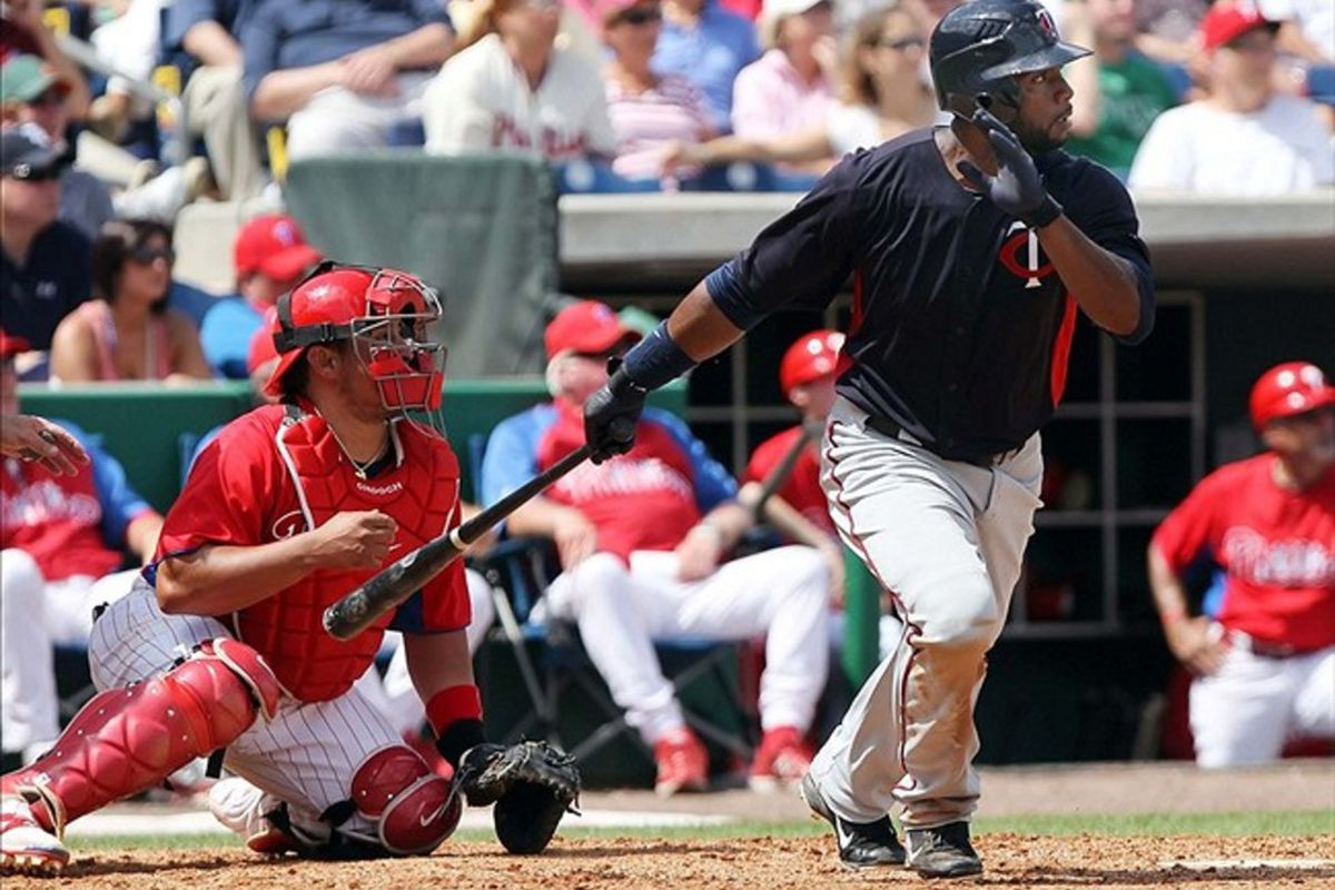 March 14, 2012; Clearwater, FL, USA; Minnesota Twins center fielder Denard Span (2) hits a single in the fourth inning against the Philadelphia Phillies at Bright House Networks Field.  Mandatory Credit: Kim Klement-US PRESSWIRE