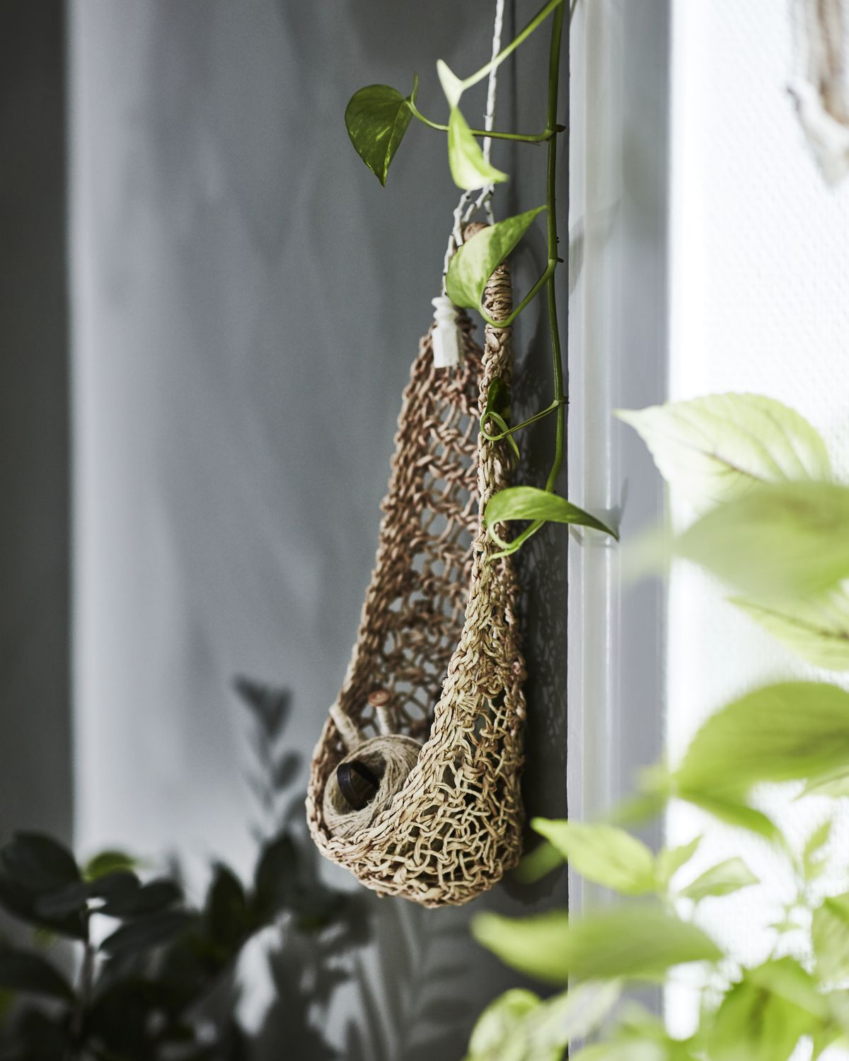 Woven basket hanging from wall.